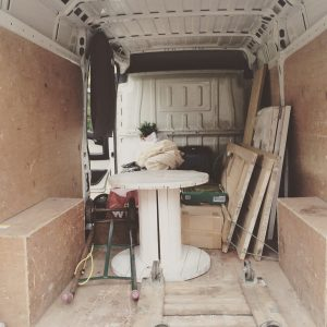Loading the van, contemplating the work ahead.